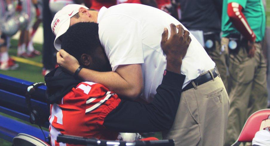 Tom Herman hugs J.T. Barrett before the Sugar Bowl.
