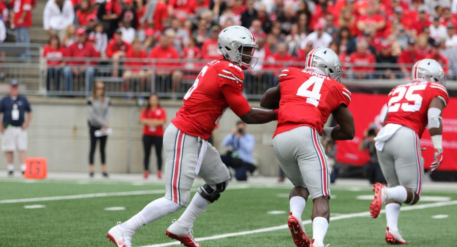 J.T. Barrett hands off to Curtis Samuel against Rutgers.