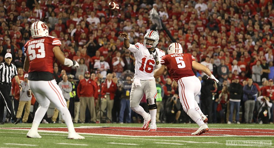 Ohio State quarterback J.T. Barrett lets go of a pass against Wisconsin.