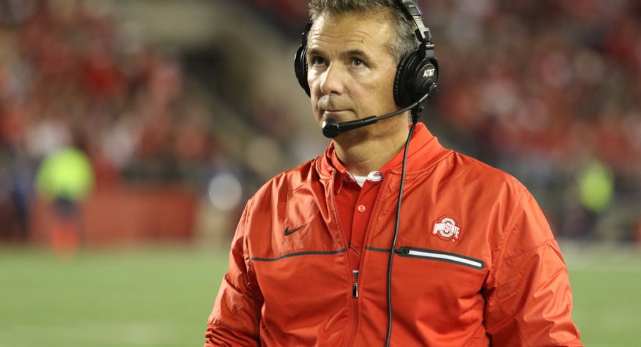 Ohio State coach Urban Meyer strolls the sidelines at Wisconsin.