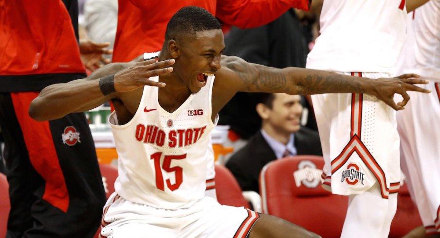 Ohio State's Kam Williams celebrates on the bench.