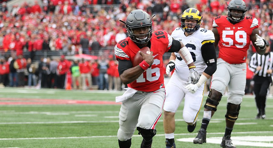 J.T. Barrett carries the ball against Michigan.