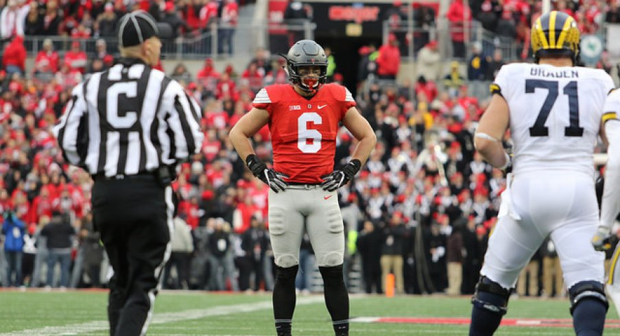 Sam Hubbard stands tall against Michigan.