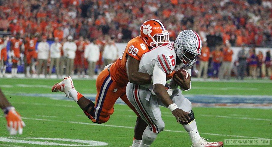 Clemson's Clelin Ferrell brings down Ohio State quarterback J.T. Barrett.