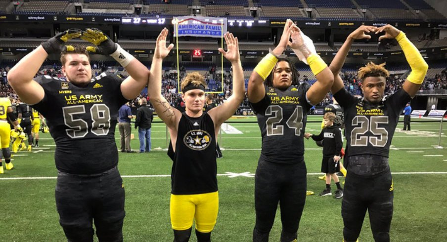 Josh Myers, Tate Martell, Chase Young and Shaun Wade spell out O-H-I-O