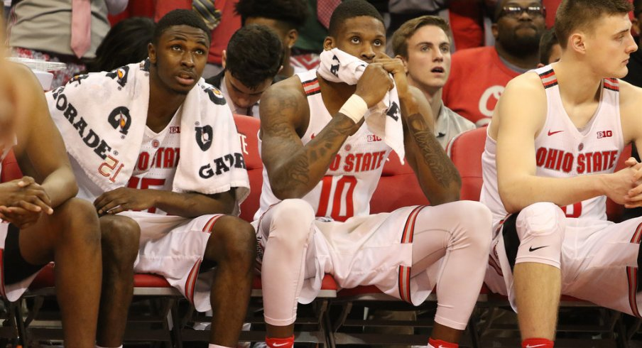 Kam Williams, Dave Bell and Micah Potter on the bench during Ohio State's loss to Northwestern.
