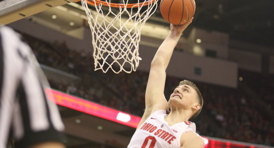 Ohio State's Micah Potter dunks during Sunday's game against Northwestern.