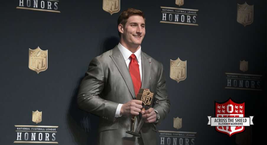 Joey Bosa poses with his NFL Defensive Rookie of the Year trophy.