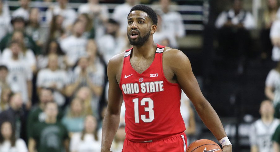 Ohio State point guard JaQuan Lyle holds the ball at Michigan State.