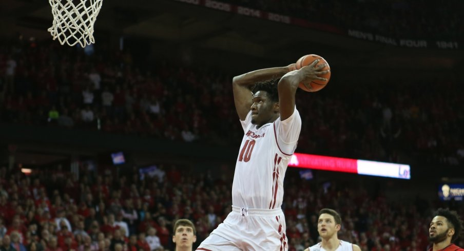 Feb 19, 2017; Madison, WI, USA; Wisconsin Badgers forward Nigel Hayes (10) prepares to dunk the ball at the end of the game with the Maryland Terrapins at the Kohl Center. Hayes later apologized for the dunk during the post-game news conference. Wisconsin defeated Maryland 71-60. Mandatory Credit: Mary Langenfeld-USA TODAY Sports