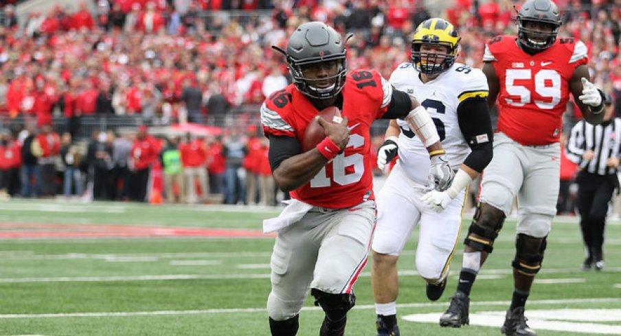 Ohio State quarterback J.T. Barrett scores against Michigan.