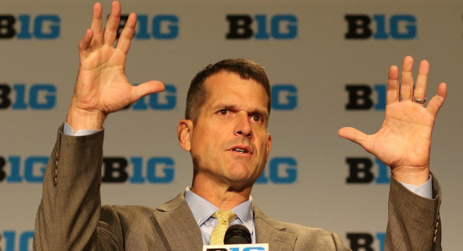 Jim Harbaugh delivers a press conference