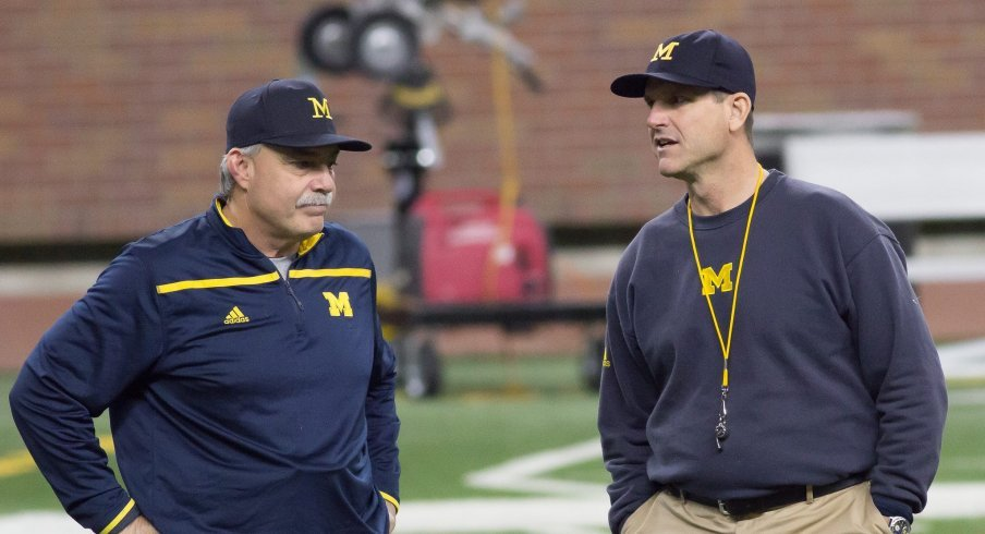 Don Brown and Jim Harbaugh discuss the Wolverine defense.