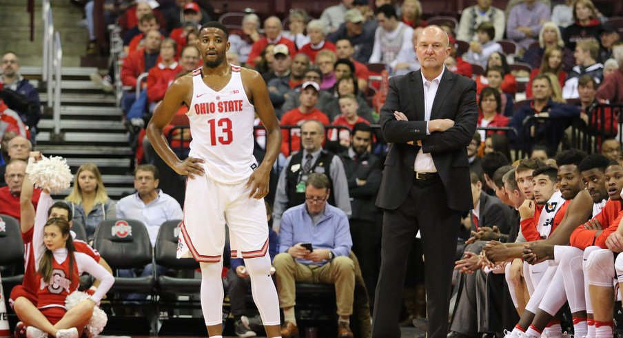 JaQuan Lyle and Thad Matta stand in front of Ohio State's bench last season.