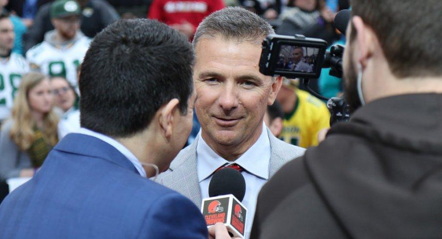 Urban Meyer conducts an interview