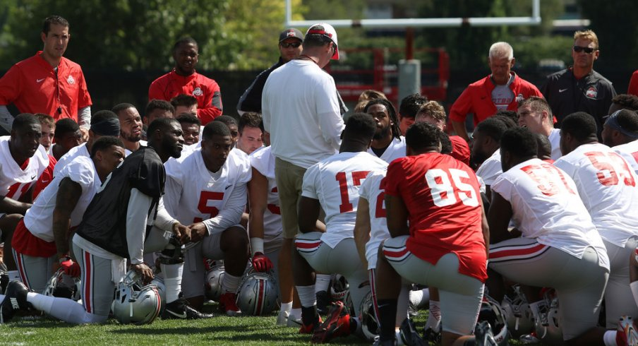 Urban Meyer addresses his team during fall camp last season.