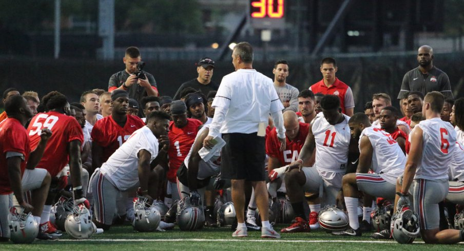 Urban Meyer talks to his team during its first preseason practice on July 27.
