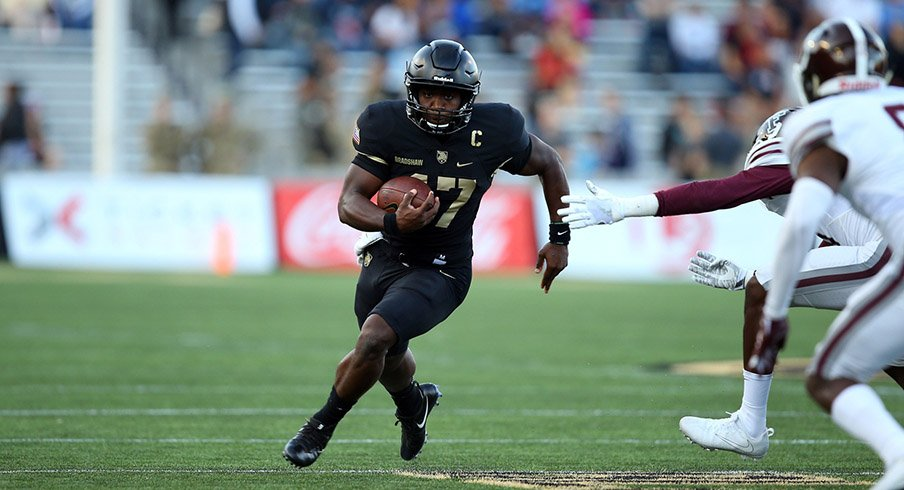 Army Black Knights quarterback Ahmad Bradshaw (17) rushes the ball against the Fordham Rams during the first half at Michie Stadium.