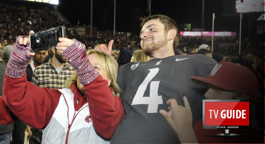 Sep 29, 2017; Pullman, WA, USA; Washington State Cougars quarterback Luke Falk (4) takes a selfie with a fan after a game against the USC Trojans during the second half at Martin Stadium. The Cougars won 30-27. Mandatory Credit: James Snook-USA TODAY Sports