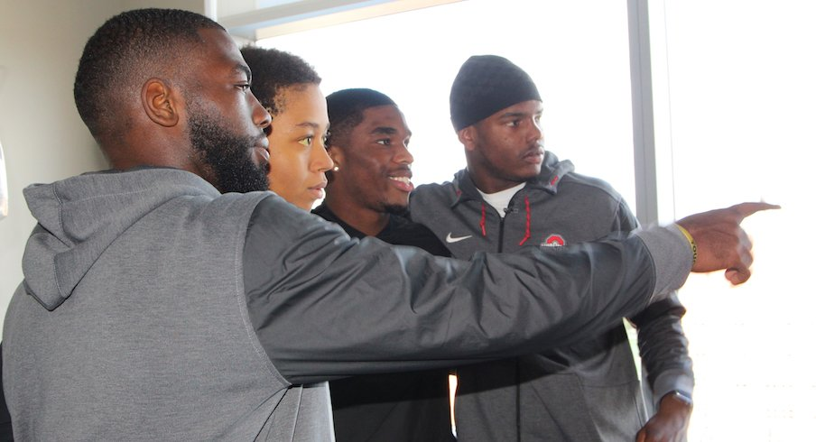 J.T. Barrett, Jeffrey Okudah and Jaylen Harris were among six Ohio State football players who visited the James Cancer Hospital on Monday.