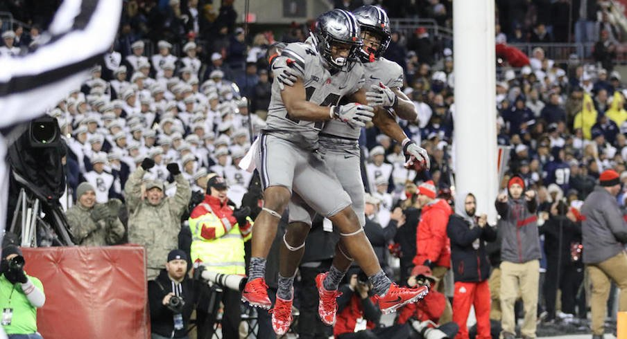 K.J. Hill and Johnnie Dixon celebrate one of the Buckeyes' three fourth-quarter touchdowns.