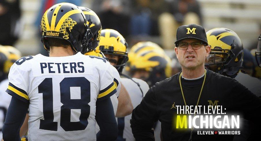 Michigan quarterback Brandon Peters and Michigan head coach Jim Harbaugh