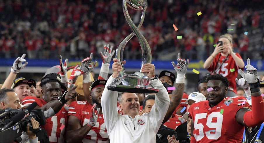 Dec 29, 2017; Arlington, TX, USA; Ohio State Buckeyes coach Urban Meyer holds the championship trophy after the 2017 Cotton Bowl against the Southern California Trojans at AT&T Stadium. Ohio State defeated USC 24-7. Mandatory Credit: Kirby Lee-USA TODAY Sports