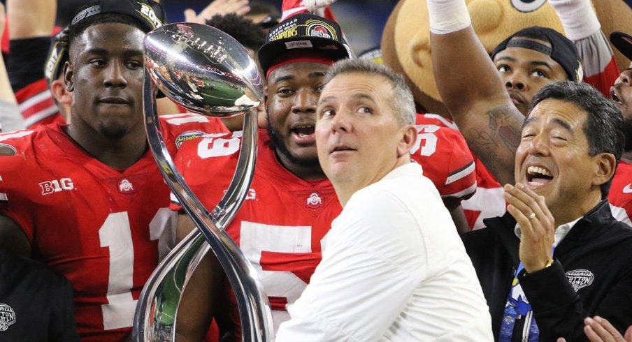Urban Meyer and the Cotton Bowl Trophy