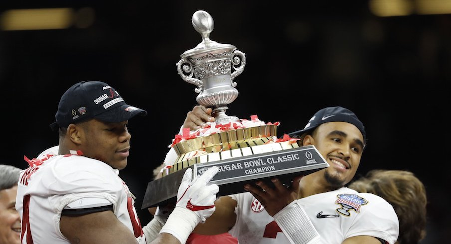 Alabama's Da'Ron Payne and Jalen Hurst celebrate after defeating Clemson in the College Football Playoff semifinal at the Sugar Bowl.