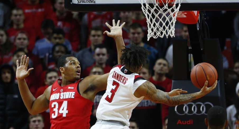 Kaleb Wesson defends a shot by Rutgers' Corey Sanders.