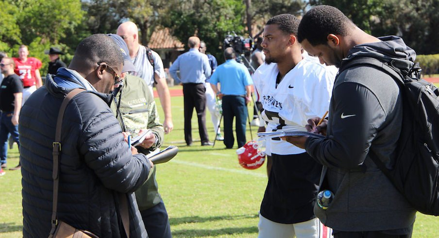 Damon Webb meets with NFL scouts after Tuesday's Shrine Game practice.