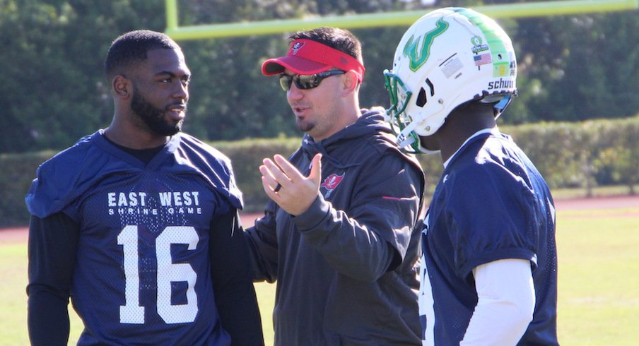 Zack Grossi (middle) coaches J.T. Barrett and USF quarterback Quinton Flowers at the East-West Shrine Game.