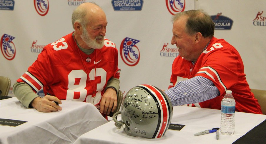 Former Ohio State defensive end Mark Debevc (83) and linebacker Dirk Worden (56), both members of the 1968 national championship team, at Saturday's autograph signing.