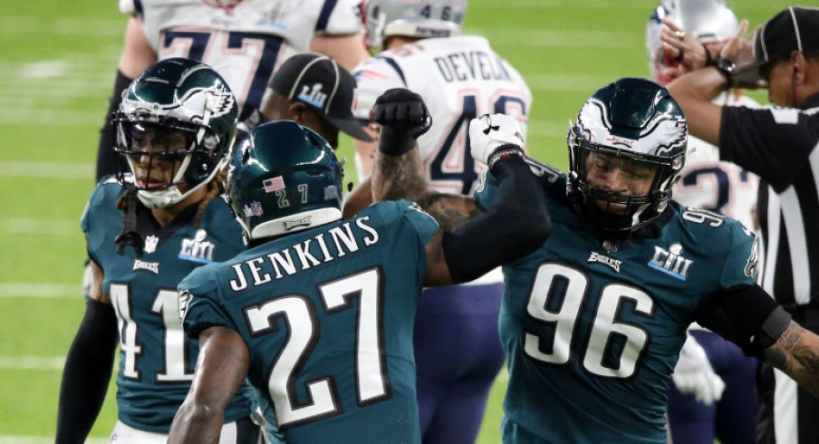 Feb 4, 2018; Minneapolis, MN, USA; Philadelphia Eagles strong safety Malcolm Jenkins (27) celebrates with defensive end Derek Barnett (96) after a hit on New England Patriots wide receiver Brandin Cooks (14) during the second quarter in Super Bowl LII at U.S. Bank Stadium. Mandatory Credit: Charles LeClaire-USA TODAY Sports