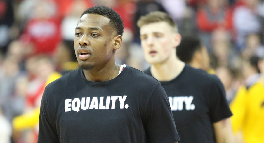"Andre Wesson and Micah Potter wearing ""Equality"" shirts to recognize Black History Month before Saturday's game against Iowa."