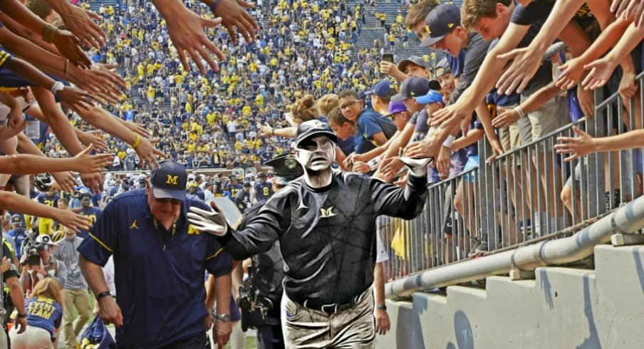 Sep 16, 2017; Ann Arbor, MI, USA; Michigan Wolverines head coach Jim Harbaugh high five with fans after defeating the Air Force Falcons at Michigan Stadium. Mandatory Credit: Rick Osentoski-USA TODAY Sports