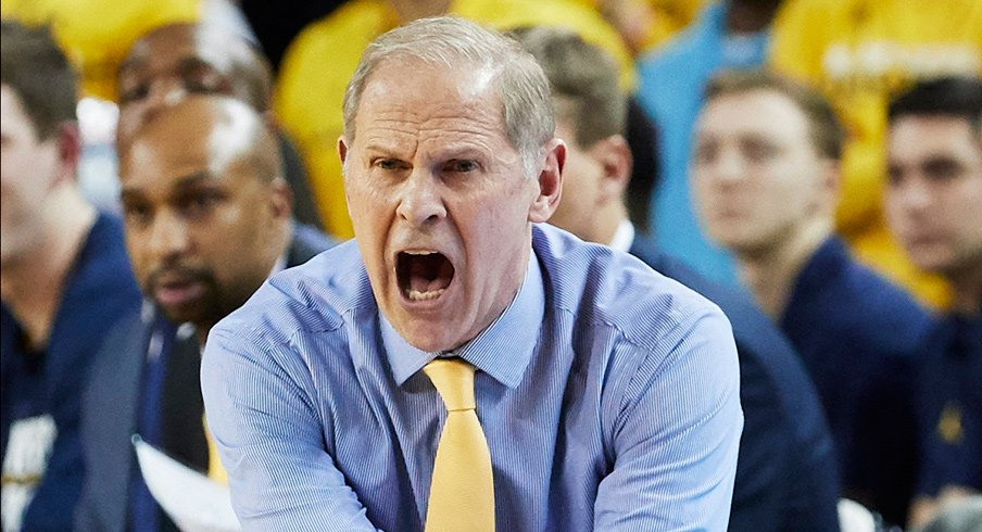 USA; Michigan Wolverines head coach  reacts on the sideline in the second half against the Northwestern Wildcats at Crisler Center. Mandatory Credit: