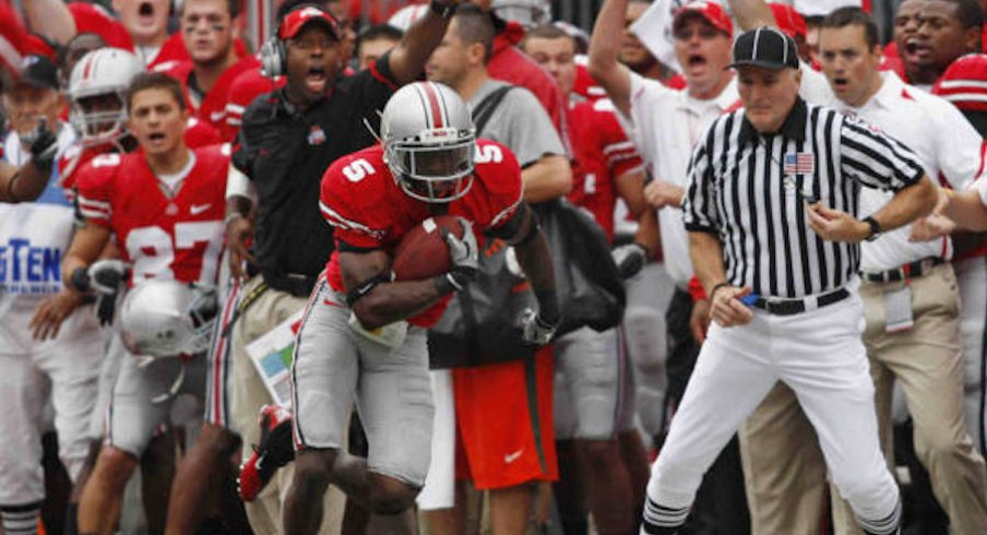 Chimdi Chekwa intercepts a pass against Miami in 2010 with Taver Johnson cheering in the background.