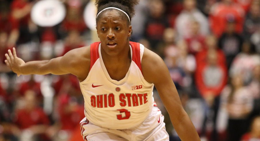 Kelsey Mitchell passes Jackie Stiles.