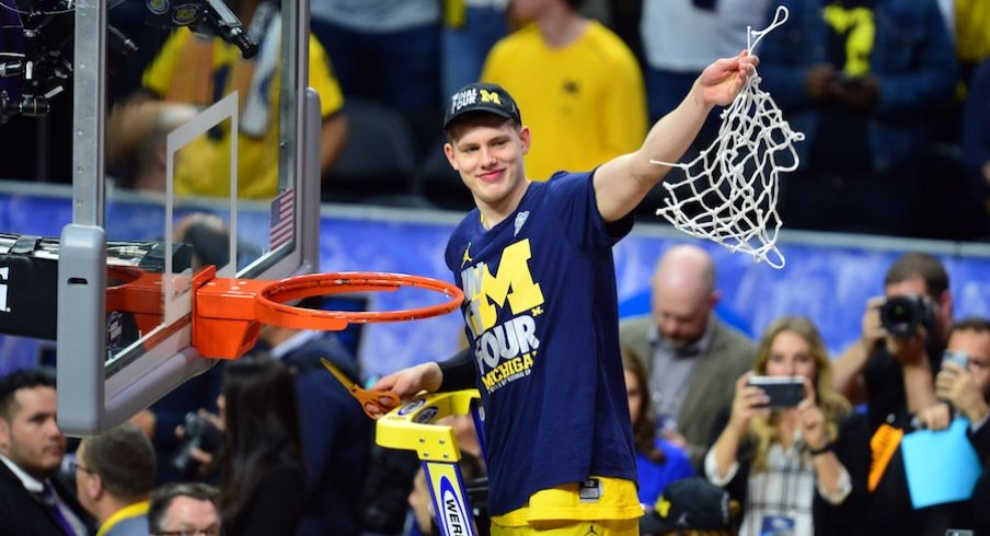 March 24, 2018; Los Angeles, CA, USA; Michigan Wolverines forward Moritz Wagner (13) cuts down the net following the 58-54 victory against the Florida State Seminoles in the championship game of the West regional of the 2018 NCAA Tournament at STAPLES Center.
