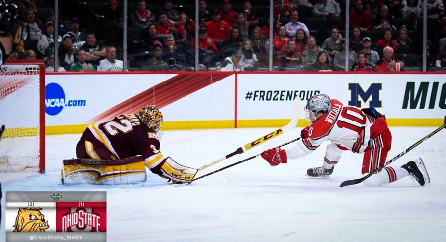 Ohio State forward John Wiitala takes the puck to the net against Minnesota-Duluth goalie Hunter Shepard.