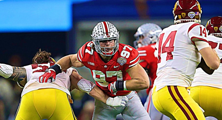 Dec 29, 2017; Arlington, TX, USA; Ohio State Buckeyes defensive end Nick Bosa (97) applies pressure in the second quarter against Southern California Trojans quarterback Sam Darnold (12) in the 2017 Cotton Bowl at AT&T Stadium.