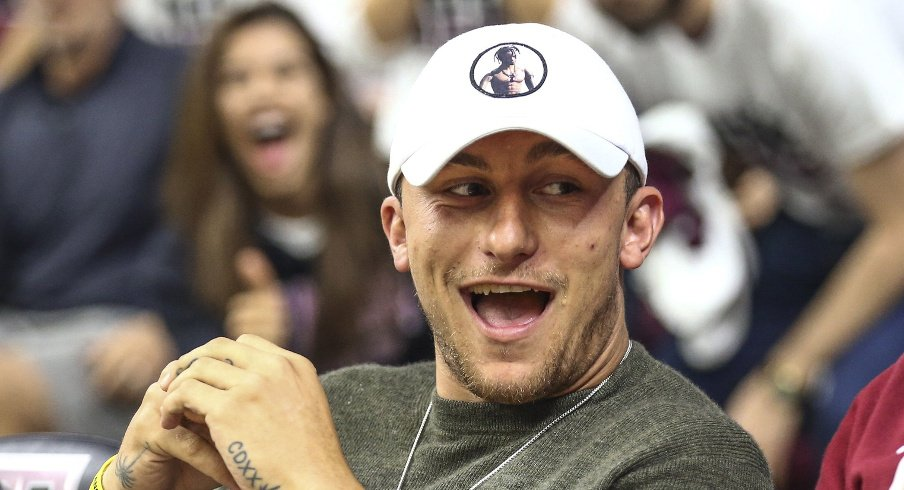 Mar 4, 2017; College Station, TX, USA; Former Texas A&M Aggies quarterback and 2012 Heisman Trophy winner Johnny Manziel watches a game against the Kentucky Wildcats at Reed Arena. Mandatory Credit: Troy Taormina-USA TODAY Sports