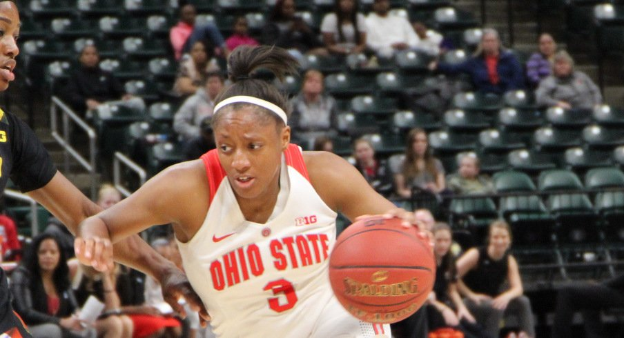 Kelsey Mitchell drives against Maryland in a Big Ten tournament game