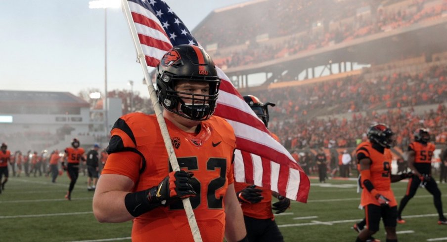 Oct 26, 2017; Corvallis, OR, USA; Oregon State Beavers offensive lineman Sumner Houston (52) carries the American Flag onto the field before the game against the Stanford Cardinal at Reser Stadium. Mandatory Credit: Scott Olmos-USA TODAY Sports