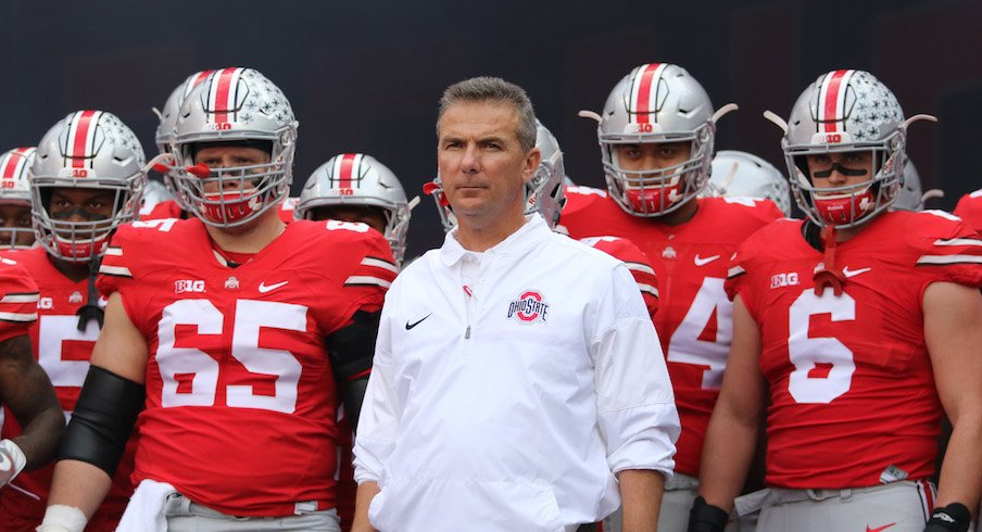 Urban Meyer and two players he redshirted.