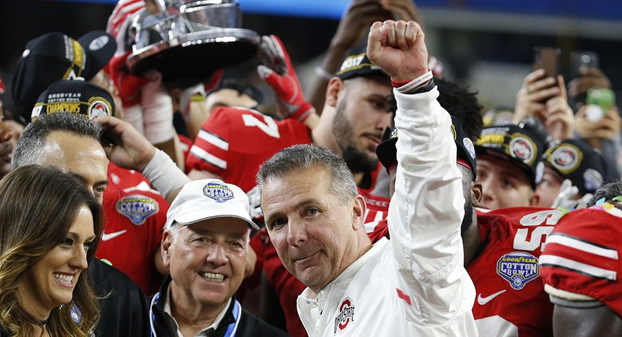 Urban Meyer celebrates his team's Cotton Bowl win over USC.