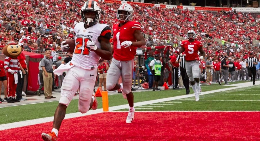 Oregon State Beavers running back Artavis Pierce (21) scores a touchdown against the Ohio State Buckeyes during the second half at Ohio Stadium.