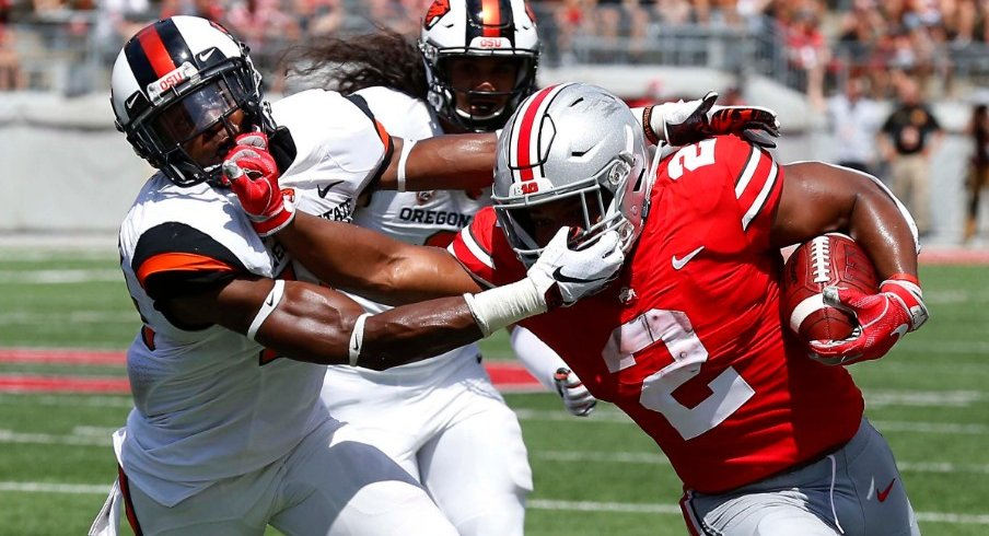 Ohio State's J.K. Dobbins breaks a tackle during Saturday's 77-31 win over Oregon State.