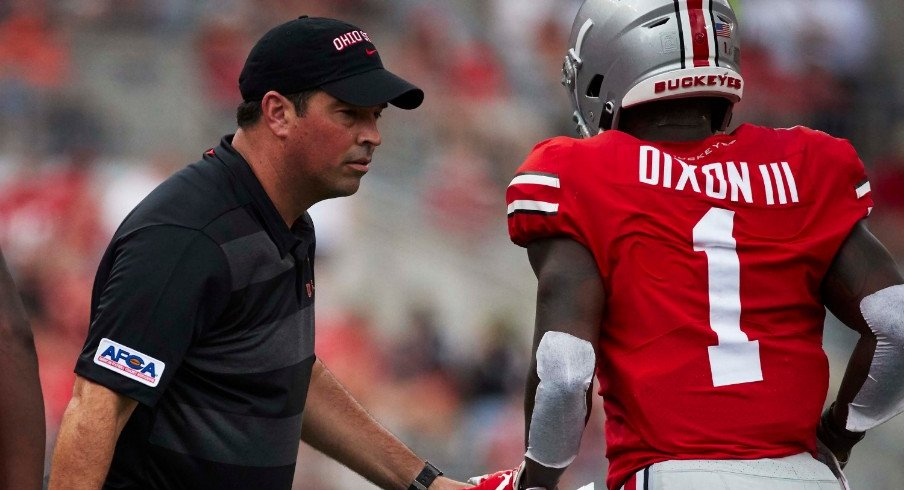 Ohio State acting head coach Ryan Day talks to Ohio State wide receiver Johnnie Dixon (1) during the second half against the Oregon State Beavers at Ohio Stadium.
